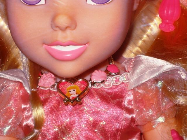 Princess Aurora Doll with Heart Necklace Closeup